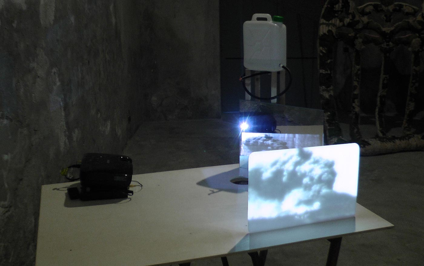 drawing's image projected on glass, water, multimedia material. Installation view BOCS Catania
