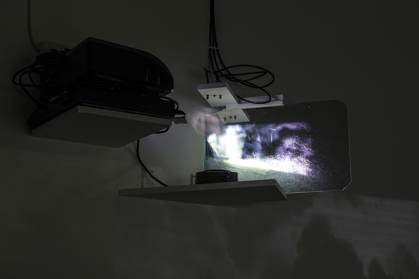 photographic image, electricity, hot plate, vapor, drop installation, glass, video equipment. Site specific installation
