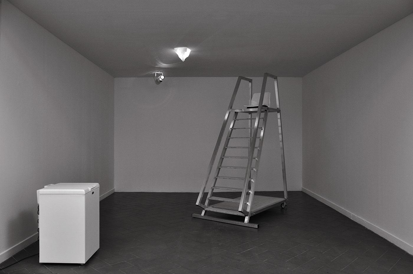 iceberg in ice, light projector, alluminium ladder and wooden, freezer box. 2010